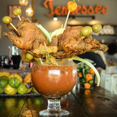 Bloody Mary that's topped with two pieces of fried chicken on sticks, avocado, fried okra. It's literally a brunch fit for two. Loved by Nashville Vacation Home right across the street from the BEST Nashville HOT Chicken place Nashville Broadway, Nashville Bars, Nashville Vacation, Tennessee Vacation, Nashville Tennessee, Visit Nashville, East Tennessee, Best Restaurants In Nashville, Nashville Brunch