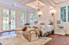 Master bedroom with french doors, plush loveseat and engineered acacia flooring Master Bedroom Addition, Small Master Bedroom, Master Bedrooms, Master Suite, Bedroom With Sitting Area, Tropical Bedrooms, Traditional Bedroom, Traditional Design, Luxurious Bedrooms