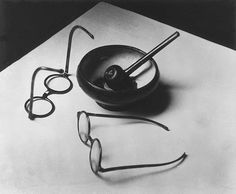 Mondrian's Pipe and Glasses, Paris 1926 - Andre Kertesz This photograph synthesizes the modernist ideas promoted new forms of expression, which aimed to express the 'lyrical beauty' of the world of objects. Through his instinctive ability to integrate refined, abstract forms, Kertész captures the spirit of Mondrian's paintings.