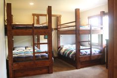 Two Queen over Queen Bunk Beds, knotty alder construction, Antique Mahogany finish. Integrated ladders, Black integrated bunk bed low voltage lighting. Left Bunk has twin trundle that pulls out from the end. Right bunk has wide drawer for bedding that pulls out from the side. Delivered to Breckenridge, Colorado.
