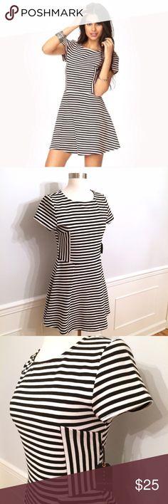 "Striped Dress! NWT! Sz. M. Super cute black and white striped dress. 32"" shldr to hem. UA to UA 16"". Waist 15"". 78% polyester 21% cotton 1% elastase. Brand new with tags. Smoke free, clean home. Forever 21 Dresses Mini"