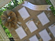 Table Plan | Burlap, white and grey.  Mounted on to a mirror with a white vintage frame.
