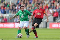 Andy Reid challenges for the ball as Keane plays a pass in front of him during the second-half of the game in Cork Manchester United Legends, Manchester United Football, Roy Keane, Victoria Justice, Two By Two, Challenges, The Unit, Running, Plays