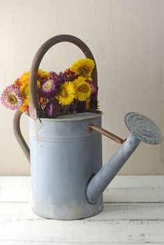 Rustic Watering Can Metal 8in. Use it to water your garden or as a unique vase for a flower arrangement