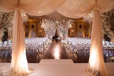 Elegant Drapery at Indoor Ceremony    Photography: Bob %26 Dawn Davis Photography   Read More:  http://www.insideweddings.com/weddings/glamorous-ivory-blush-spring-wedding-at-a-private-club-in-chicago/685/