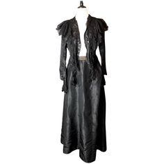 A beautiful antique Victorian two piece mourning dress.pIt features a long plain black silk skirt with an A line shape and a Webbed waistline, fastening with hook and eye fasteners.pThe blouse is also made from black silk and satin with a v neck, trimmed in black lace around the neckline and down the front, this lace trim extends over the shoulders and down the back.pThe cuffs are a beautiful elongated slim shape and crocheted with floral patterns.pThe bodice had a cotton lining and used to have Victorian Life, Victorian Fashion, Plain Black, Black Silk, Dress Outfits, Fashion Outfits, Dresses, Mourning Dress, Bodice