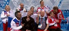 Evgeni Plushenko and Team Russia after his FS