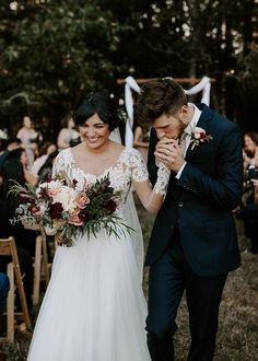 There's nothing cuter than the look of joy that couples share in their wedding recessional photos. #WeddingPhotography