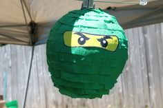I made this for my son's Ninajago party. Simple 'punching' balloon, paper mache' and streamer wrapped around a few times then glue eyes on.  Made for under $4