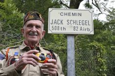 Memories: Mr Schlegel, who served in the 82nd Airborne unit of the U.S. Army, poses in front of this country road in Picauville, near Sainte-Mere-Eglise, which was named after him