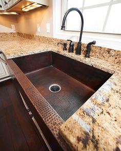 Covington Legacy | Flickr - Photo Sharing! Venetian Gold Granite Countertops, Avalon Tuscan Bronze Single Control Faucet with Matching Sprayer and Soap Dispenser.