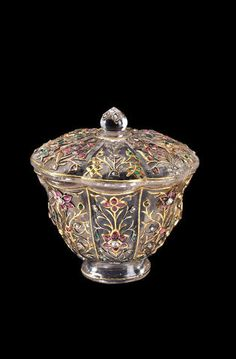 A Mughal carved rock crystal cup, set with emeralds, rubies, diamonds and gold. Northern India, 18th century.
