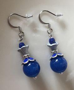 A personal favorite from my Etsy shop https://www.etsy.com/listing/603262343/blue-chalcedony-silver-enamel-flower