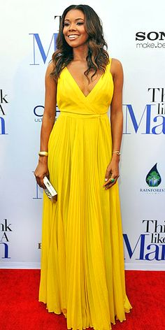bright yellow, pleated skirt, crossover top, gold embellishments and Gabrielle Union. gorgeous.