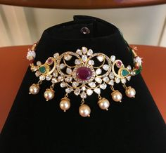 Stunning choker or arm band in peacock design. Choker studded with uncut diamonds rubies and emeralds. Choker having pearl hangings. Indian Jewellery Design, Indian Jewelry, Jewelry Design, Designer Jewelry, Necklace Designs, Necklace Ideas, Jewelry Patterns, Gold Jewelry, Gold Necklaces
