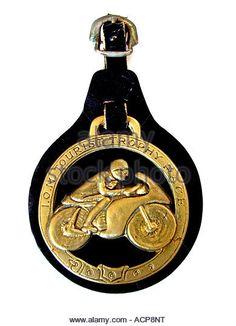 Horseshoe brass. Horse brasses. On white background. Isle of Man TT races - Stock Image