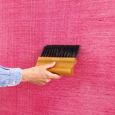 BH&G;: create a chambray-look wall by rolling a tinted glaze over a white/cream-colored wall, then dragging a weaver brush through wet glaze.