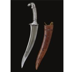 A MUGHAL STEEL-HILTED CHILD'S DAGGER WITH SCABBARD, NORTH INDIA, 17TH CENTURY the slender curved double-edged watered-steel blade with swollen tip and central ridge, the steel hilt with fluted grip terminating in a pommel in the form of a ewe's head with drooping ears and engraved fleece, leather-covered wood scabbard