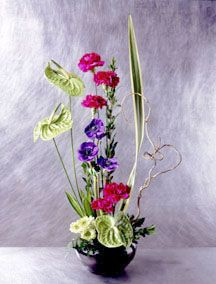 flower arranging styles | Flowers featured: fuchsia carnations, purple anemones, white asters ...