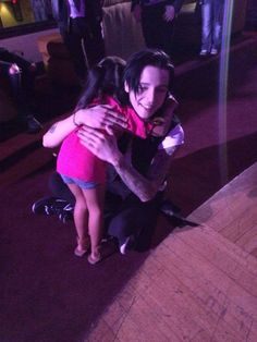 Andy Biersack<<< Oh yes, emo bands are so evil. Look at this satanist hugging a little girl. -Dawn.