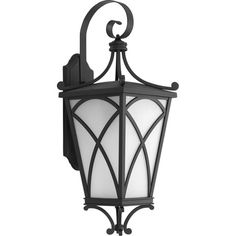 One-light wall lantern with a decorative and fashion oriented design with modern classic styling. A frosted glass shade, cast overlay design and die-cast aluminum, powder coated frame in Black.