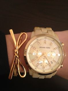 bow bracelet + gold Michael Kors watch