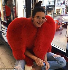 Laughter is the best medicine: Kendall Jenner seemed relaxed as she posed in a Saint Laurent fur wrap in this picture posted to Instagram