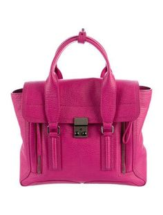 Bright fuchsia Shark embossed leather 3.1 Phillip Lim Medium Pashli satchel with gunmetal hardware, dual rolled handles, detachable flat shoulder strap, dual expandable zip gussets at front, black canvas lining, single interior zip pocket and push-lock closure at front flap. Includes tags. Shop 3.1 Phillip Lim consignment handbags at The RealReal.