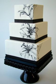 An elegant three tier black and white cake with a floral design - The Butter End Cakery #blackandwhite #cakes