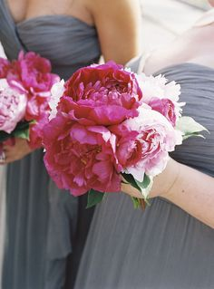 gray maid dresses with the bright pink bouquets