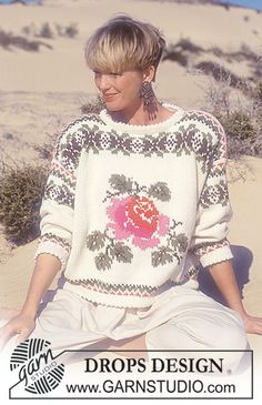 "DROPS 26-18 - DROPS jumper with rose and pattern borders in ""Paris"". - Free pattern by DROPS Design"