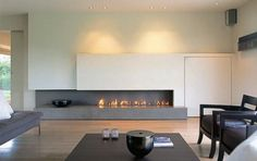 Fireplaces by MetalFire, futuristic design in modern interior living room