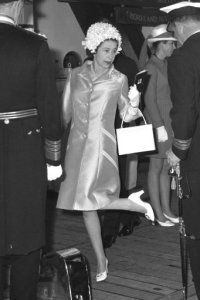 07-29-69 Queen Elizabeth II shows her shoe to high-ranking officers aboard HMS Eagle.