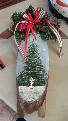 This little sleigh is my design and looks much better with the greenery