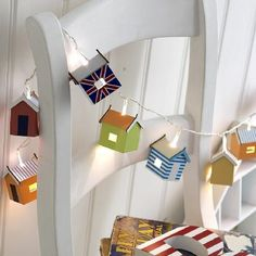 These delightful little beach hut lights are handmade and handpainted 12 beach hut lights boxed Total length 4 1 65