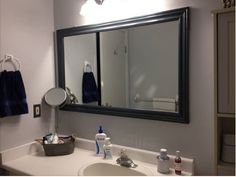 DIY - my under $50 bathroom face lift - primed and painted the walls, then added painted trim to the boring mirror - it wasn't to hard at all...LOVING IT