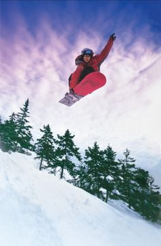 A snowboarder catching some air on one of Maine's great mountains. Are you ready for some snow?