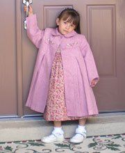 Rosys, posy's, and warm toesys! This is just the coat you need for your little girl this coming winter season! It is a beautiful shade of pink with a Peter Pan collar, two fastening buttons on the front, and it has hand embroidery on the chest with silk ribbon.  $93.99