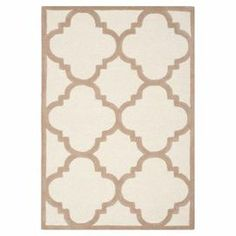 Wool rug with a quatrefoil motif. Hand-tufted in India.     Product: RugConstruction Material: WoolColor: Ivory and beigeFeatures: Hand-tuftedNote: Please be aware that actual colors may vary from those shown on your screen. Accent rugs may also not show the entire pattern that the corresponding area rugs have.Cleaning and Care: Professional cleaning recommended