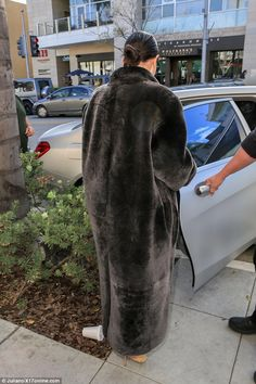 She's fur-real: Taking the look from wearable to you have to a be a celebrity to replicate it, Kim wore it with a full length black fur coat