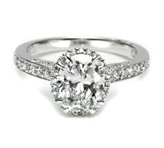Oh!val delight.  The unusual center diamond takes this classic ring style and expresses unique distinction.  Style no. 2620OVLGP (TACORI)