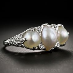 A lustrous trio of natural pearls shimmers almost solo from this exquisite Edwardian-era ring (circa lovingly crafted in platinum and delicately ornamented with fanciful filigree work and teeny-tiny diamonds glittering on the leaf-motif shoulders a Jewelry Show, Pearl Jewelry, Jewelery, Silver Jewelry, Fine Jewelry, Jewelry Ideas, Antique Rings, Vintage Rings, Antique Jewelry