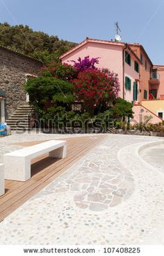 Sold! Stock photo available for sale at Shutterstock: Small square with nice pavement and benches at Capraia Island, Tuscan Archipelago, Italy.