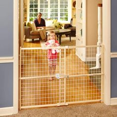The Quick-Fit Wire Mesh Gate is especially designed for those wide openings in today's homes. This gate pressure mounts easily and securely without the use of hardware or tools. The Quick-Fit mechanis Extra Wide Baby Gate, Retractable Baby Gate, Metal Baby Gate, Kids Gate, Pet Gate, Baby Gates, Wire Mesh, Baby Safety, Baby Design