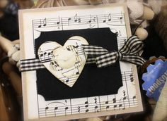 A Valentine card in black and white with sheet music