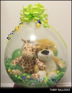 """Jungle Themed (Giraffe and Lion) on """"Grass"""" stuffed balloons! Great for centerpieces and Gifts for any jungle themed party! this is sweet. Balloon Arrangements, Balloon Centerpieces, Balloon Decorations, Balloon Ideas, Baby Balloon, Balloon Gift, Baby Shower Balloons, Baby Shower Deco, Baby Shower Themes"""