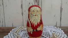 Check out this item in my Etsy shop https://www.etsy.com/listing/553637295/vintage-wooden-nesting-santa-claus