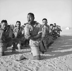Maori Battalion survivors of action in Greece performing a haka in Helwan Egypt for the King of Greece July 1941.