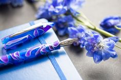 A new fountain pen has blossom in the Edison Nouveau Premiere line! Introducing Delphinium, the 15th seasonal edition in our collection of collaborations with Edison Pen Co. This blue and purple swirled masterpiece will set your creativity blooming and growing like a gorgeous flower. Pin for Later.