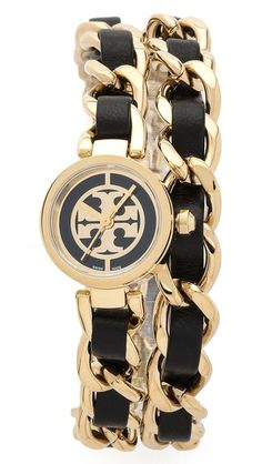 A petite Tory Burch wrap watch with an interwoven chain band. A logo emblem accents the circular dial. Scratch resistant.  Tory Burch Mini Reva Double Wrap Watch